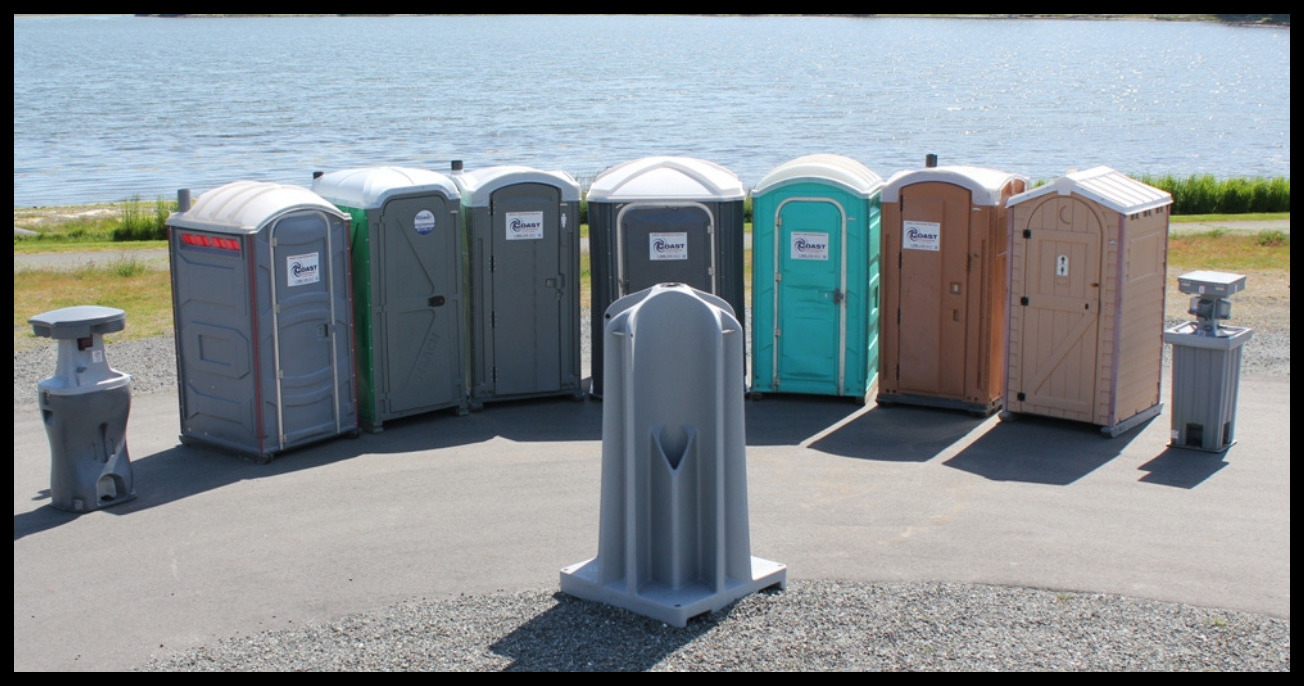 line of mobile toilets at an event